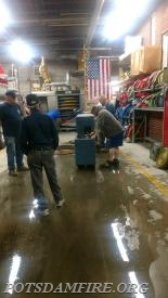 Potsdam members washing and drying Parishvilles fire hose from a garage fire they recently had