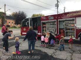 Fire Driver Pierce showing the children the different equipment on the fire trucks
