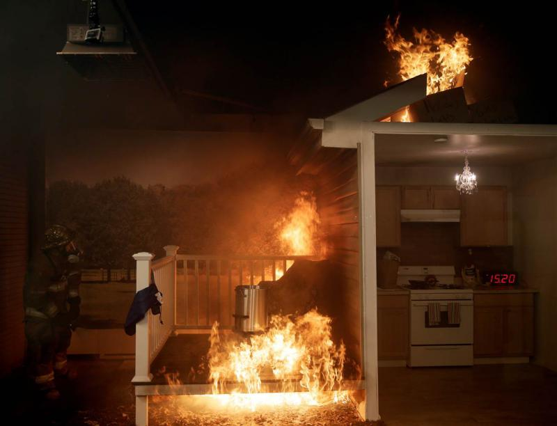 A firefighter, left, attempts to put out a fire after a frozen turkey was dropped into a hot deep fryer at a Consumer Product Safety Commission safety demonstration in Rockville, Maryland, on Nov. 22. Gary Cameron / Reuters