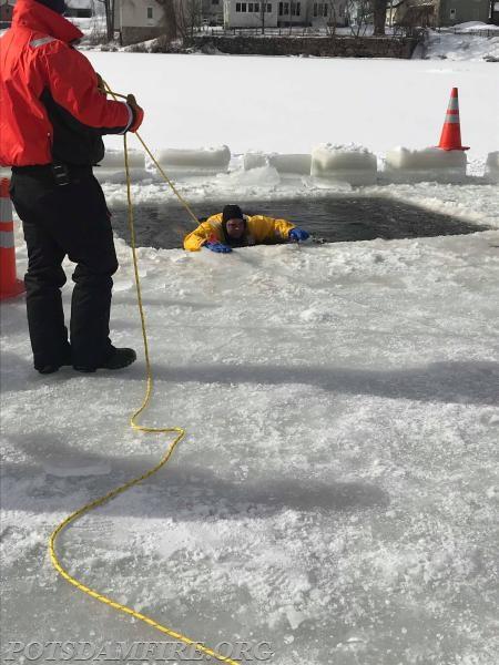 Member J. Kozak self-extricating himself from the water