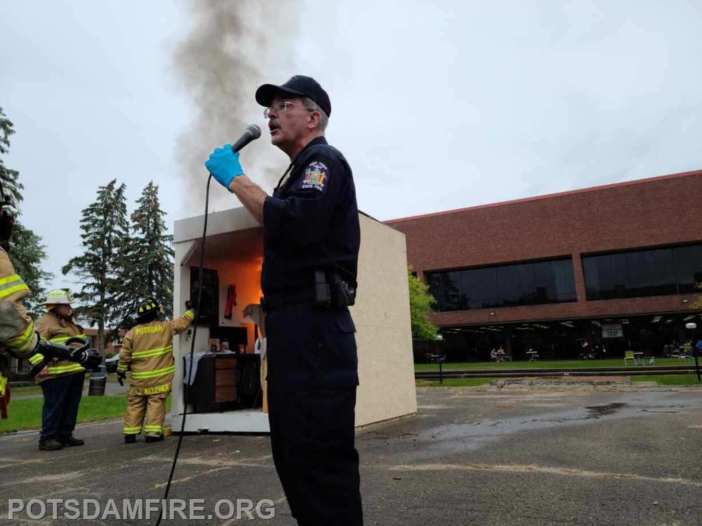 Fire Protection Specialist Christopher Taylor from the New York State Office of Fire Prevention and Control narrates the dorm burn presentation.
